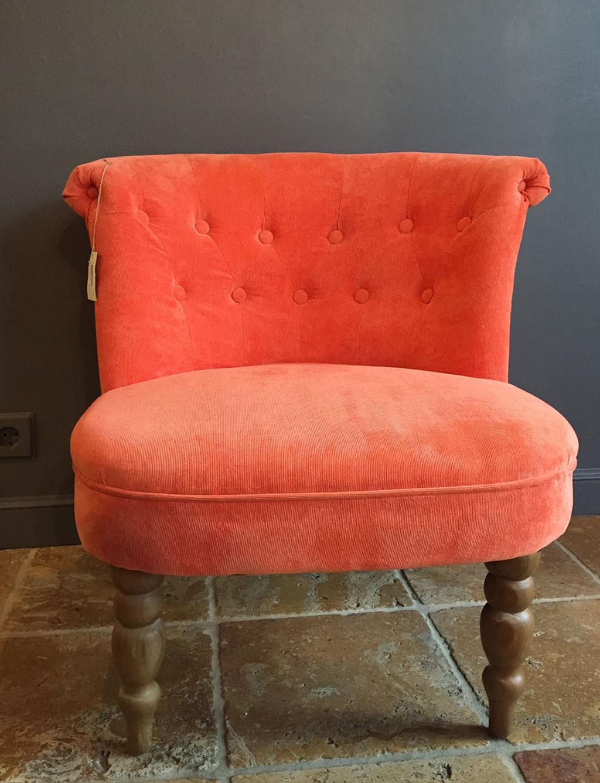 Sillón tapizado pana naranja